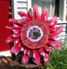 """Red Gerber Daisy made entirely from old bushel crab baskets from the eastern shore. 30"""" across painted with enamels, they can be displayed outside. by Dawn Tarr DAWN TARR ART"""