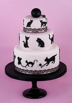Fondant cat cake...would have to do blue and pink though.