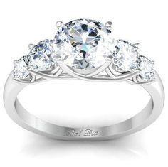 Five stone diamond engagement ring with trellis setting.