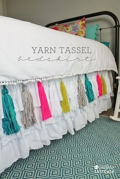 You can also add tassels to a blanket or bedskirt for a pop of color. | 28 Super Easy Yarn DIYs That Require Zero Knitting