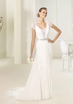 Pronovias | V-neck A-line wedding dress in crepe features embroidery decorated on the bodice and shoulder. It has a sash with crystal embellishment. LMR Weddings -- Bridal showroom in Central Hong Kong. You can find bridal gowns from international designer labels for rental and purchase.