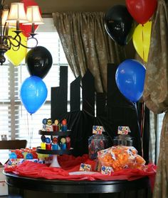 """Super Hero Party:  Now this is one of the best put-together parties I've ever seen.  The attention to details is incredible, down to personalized capes for each child, cute foods, and a chance to """"chase down a bad guy"""" outdoor activity."""