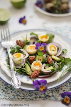 Quail egg salad with avocado and pecans