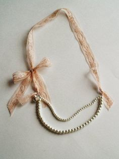 Pearl & Lace Necklace.  Now this looks vintage!  what if i found an ivory ish lace ribbon like this and tried this one?!