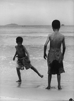 "Caption from LIFE. ""At Copacabana Beach where Gordon Parks took them, Mario and Flavio play in sand. The beach is only 10 minutes from their home but neither had ever visited it.""    Read more: http://life.time.com/history/gordon-parks-classic-photo-essay-flavio/#ixzz2KXDLU0ed"