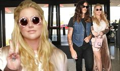 Kesha catches flight with beau Brad Ashenfelter at LAX | Daily Mail Online