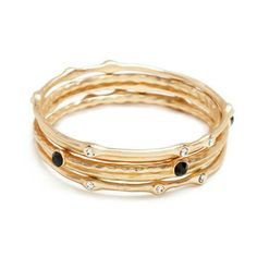 The hammered matte gold of the delicate Carolina bangles is juxtaposed perfectly by spaced black and CZ stones, for extra contrast and sparkle. Connect the dots and pair these sparklers with CZ studs.