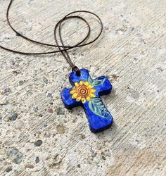 Sunflower Cross Pendant Summer means Sunflowers! This is a unique 1 inch hand-painted polymer clay cross. Colorful, in the Mexican Folk Art Art Necklaces, Unique Necklaces, Polymer Clay Projects, Polymer Clay Jewelry, Clay Cross, Diy Jewelry, Jewelry Making, Christian Gifts, Clay Charms