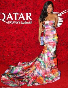 Rainbow fashion: Christina Milian pulled out all the stops and arrived in a multi-coloured...