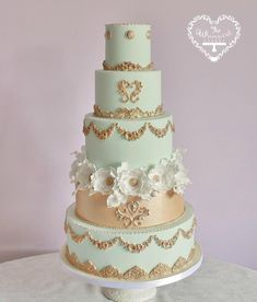 Aqua and Gold Marie Antoinette inspired wedding cake by The Whimsical Cakery - http://cakesdecor.com/cakes/217154-aqua-and-gold-marie-antoinette-inspired-wedding-cake