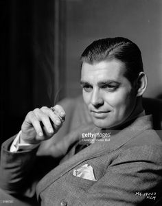 American actor Clark Gable (1901 - 1960) smoking a cigarette. Known as the King of Hollywood, he died two days after finishing filming on 'The Misfits'.