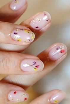You'll need teeny, tiny flowers for this trendy mani, plus a seriously strong top coat. Press your blooms between the pages of a heavy book to make them flat before adhering, then prepare for mucho compliments. See more on Amika Nails »