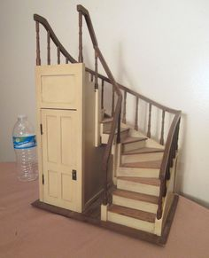 This is a stunning antique hand carved wooden salesman sample staircase. it is completely made by hand, is done with very intricate detailing, and is a high quality miniature. Miniature Furniture, Doll Furniture, Dollhouse Furniture, Diy Dollhouse, Dollhouse Miniatures, Dream Home Design, House Design, Closet Under Stairs, Patterned Furniture
