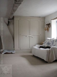 chalky paints, pale limed oak beams with fresh blue and white toile