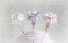 Stick pins are the new trend in scrapbooking. Add these beautiful treasures to your pages or cards. You can even pin them to your clothing, hats or scarfs!   Youll receive 3 lovely Stick Pins  Each Pin Measures 3 inches   Made with glass beads and silver filigree and mulberry flowers  Plastic clutches are included
