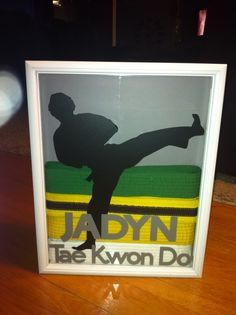 Tae Kwon Do belts displayed in a shadow box. (not a Pinterest inspiration lol)