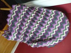 Mardi Gras chevron baby blanket.  I love making chevron blankets-- they are fast and lovely with lots of color possibilities and patterns.  It's a good pattern to use when playing with different yarn textures too.