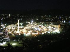 Ventura Fairgrounds Midway by flyingcamera.  Camera suspended from a kite string in low light conditions. Ventura Avenue in upper left of photo. Ventura, California
