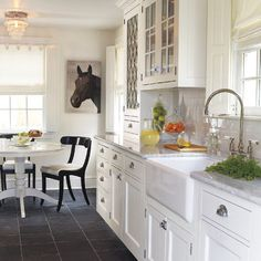clean kitchen with white cabinets, walls and counters, black slate floor Slate Floor Kitchen, White Kitchen Cabinets, Painting Kitchen Cabinets, Kitchen Flooring, Kitchen Countertops, Marble Countertops, Grey Kitchens, Home Kitchens, New Kitchen