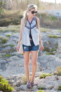 Seaside in Sicily: embroidered peasant top, denim cutoff shorts, Stuart Weitzman silver sandals, Brahmin 'Carrie' crossbody, peasant top with tassel ties