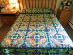 Handcrafted Full/Twin patchwork batik bed by Quiltsbysuewaldrep