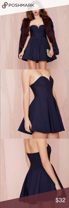 Nasty Gal • Classic navy sweetheart skater dress Nasty Gal navy strapless sweetheart style mini dress. Size S. Boning in bustier. Stretchy material. Fits XS/S. Nasty Gal Dresses Strapless