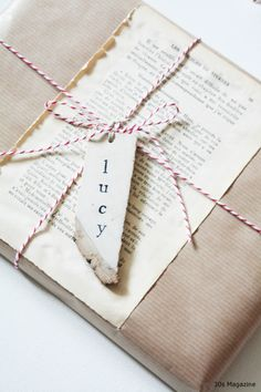 brown paper gift wrapping with page from old book//