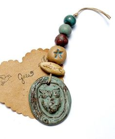Night Owl… These hand formed ceramic beads and pendant are glazed in midnight blues by Gaea Cannaday.