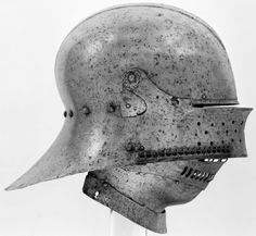 Sallet of Emperor Maximilian I (1459–1519) Attributed to Lorenz Helmschmid (German, Augsburg, ca. 1445–1516), ca. 1490–95.   This sallet was a new type probably invented by Lorenz Helmschmid for Emperor Maximilian I (1459–1519) around the time he became head of the Holy Roman Empire in 1493. Its construction, with the falling buffe (chin defense) pivoting on the same points as the visor, anticipates the development of close helmets around 1510. Wt., 4 lb. 15.7 oz. (2261 g). Met Museum.