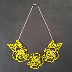 geometric roses necklace made of 3mm acrylic. laser cut design.