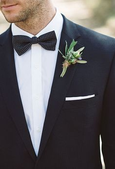 A simple boutonniere comprised of berry and gum leaves and additional greenery, created by Petal and Pod.