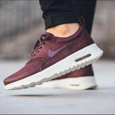 Nike Air Max Thea Mahogany Mahogany color way. Completely sold out. Seen on many bloggers and Kylie Jenner. Beautiful burgundy color!!! I love them. These are brand new never worn with box. Make offers as I'm sure it will sell quick!!! I have a size 8.5 as well. Premium leather Nike Shoes Sneakers