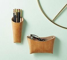 two words behind the design philosophy of craighill, a small company based in new york specializing in unique objects for your person and your home. handcrafted in their brooklyn studio, this wall pocket affixes to the wall. Modern Desk Accessories, Leather Accessories, Desk Accesories, Sewing Leather, Leather Craft, Leather Wall, Leather Workshop, Leather Gifts, Leather Projects
