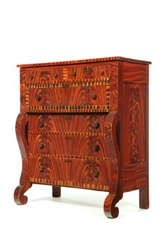 """DECORATED CHEST OF DRAWERS.   Possibly north-central Ohio, 1830-1860, poplar. Two over four drawers with scrolled stiles and feet. Retains its original, vibrant paint, including faux mahogany graining with faux crossbanding on the large drawer, and stenciled escutcheons. Retains its original pulls. 48 1/2""""h. 43""""w. 21 1/2""""d."""