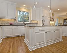 modern kitchen: blue pearl granite, white subway tile backsplash