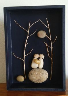 Original pebble and rock art (Couple sitting on a stone underneath moon and interlocking trees in open black shadow box