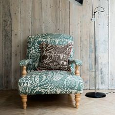 St Judes - Mark Hearld Fabric Collection - Armchair with large green and white leaf and bird print, light wood legs and armrests, brown and cream leaf/bird print cushion, floor lamp Fabric Armchairs, Upholstery Fabrics, Country Interior, Modern Country, Country Style, Printed Cushions, Fabric Wallpaper, Bird Prints, Home Living Room