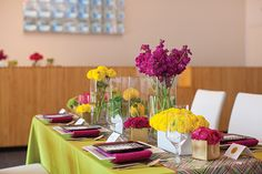 Vibrant tablescape with patterns, texture, and simply displayed florals from The Place for Flowers