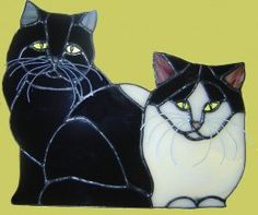Would love to have a stained glass group portrait made of all the cats I've ever been adopted by.