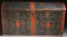"""A LARGE EARLY 19TH CENTURY NORWEGIAN WOOD TRUNK WITH ROSEMALING. In the Telemark style, inscribed """"K.F.D.D."""" and dated 1825"""