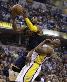 Cleveland Cavaliers' Kyrie Irving (2) shoots against Indiana Pacers' Rodney Stuckey (2) during the first half of an NBA basketball game Wednesday, April 6, in Indianapolis.