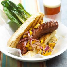 Fresh mango relish adds sweet flavor to these savory brats. More delicious cookout recipes:  http://www.bhg.com/recipes/grilling/easy-cookout-recipes/?socsrc=bhgpin052313mangorelishbrat=13