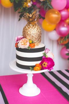 Beautiful Tropical Wedding Cakes -  striped wedding cake with bold blooms and a gilded pineapple