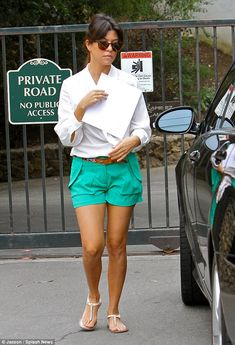 Working 9 to 5: Kourtney Kardashian stops by a Malibu office in a pair of chic green shorts