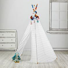 Everything looks better in lace.  That's why we adorned this teepee with lace.  This five-sided teepee includes colored poms and yarn decoration at the top, making it as elegant as it is playful.