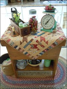 Many of my favorite things . . . vintage quilt, mason jar, jadeite, sewing machine drawer and a crock!