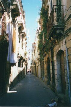 Narrow quaint street in Ortygia, Siracusa