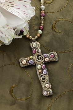 The multi-colored freshwater pearls create a unique and eye-catching cross necklace. The cross of Christ is the central symbol of the Christian faith and what better way to display your faith in Jesus