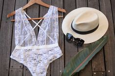 Lace bodysuit with plunging neckline. Lace thong bottom with cotton gusset. Strappy open-back with adjustable straps and adjustable waistband. Plunge Bodysuit, Lace Bodysuit, Plunging Neckline, Cotton, Tops, Summer, Women, Fashion, Moda
