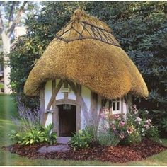 Thatched cottage fairy tale play house.